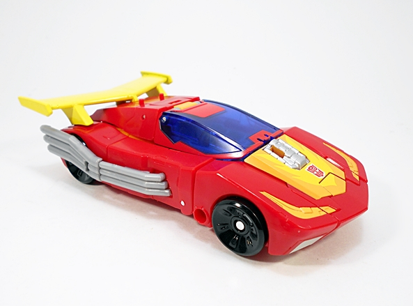 In Keeping With His G1 Namesake, Hot Rodu0027s Alt Mode Is A Futuristic Red  Sports Car With A Big Yellow Spoiler On The Back.